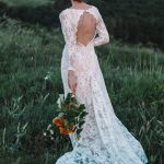 Backless wedding dress with shaped cut from behind by Anna Skoblikova