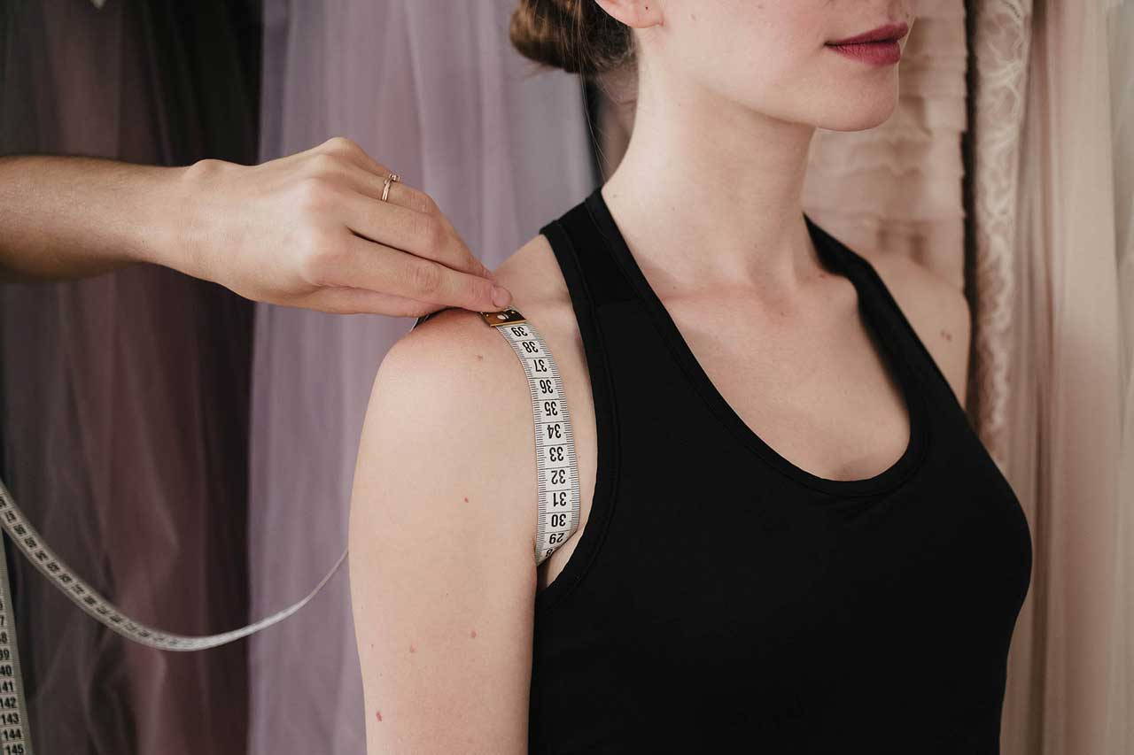 Arm hole - raise your arm parallel to floor and wrap measure tape around the armpit across the outside edge of shoulder. Pull your hand down and make sure the tape stays just vertically and only after the last take the measurement. - Anna Skoblikova