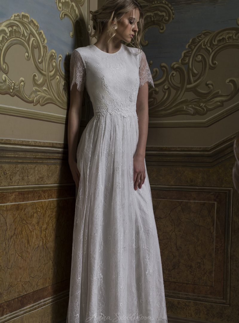 Bella - Wedding dress made from two lace types stands out for its modesty and charm - Anna Skoblikova