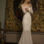 Olivia - Скромное свадебное платье с редким узором кружева подчеркивает изящество плеч и шеи  Anna Skoblikova