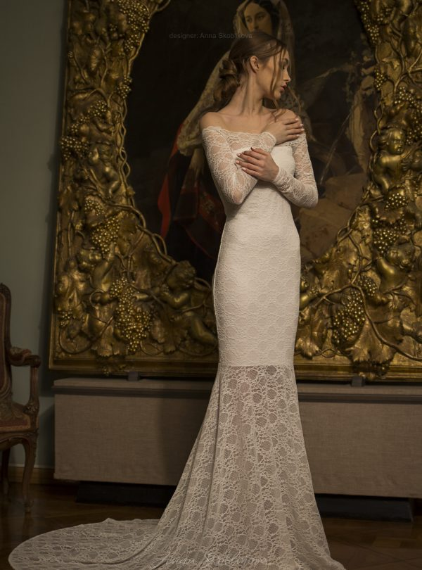 Olivia – Modest, charming, scattered lace wedding gown emphasizes the elegancy of shoulders and neck