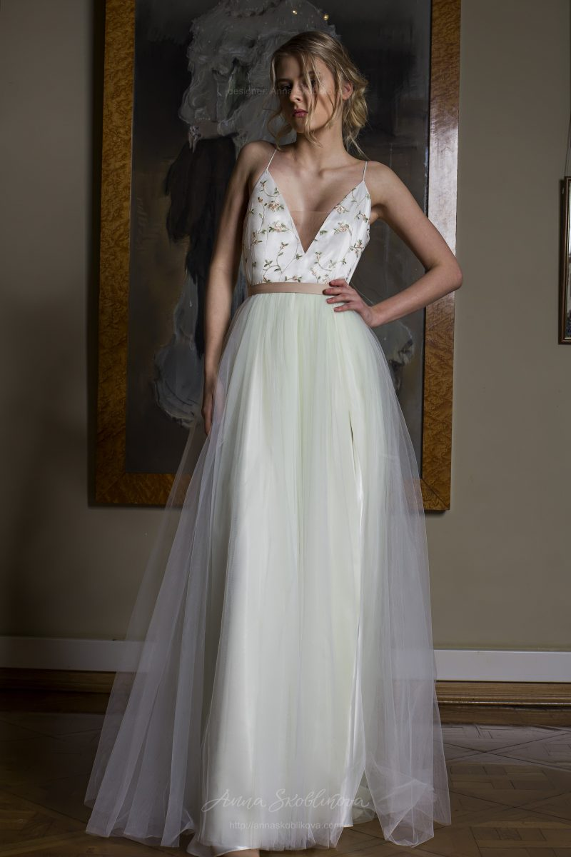 Photo 1: Unique designer wedding dress with a full skirt